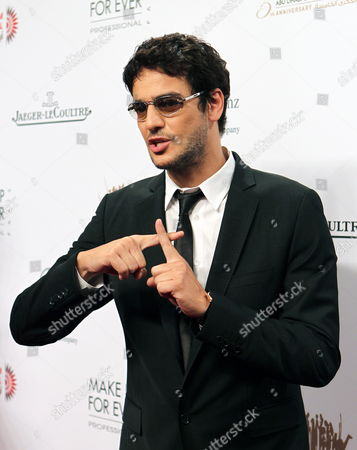 Stock Image of Egyptian Actor Khaled Abol Naga Makes the Christian Crucifix with His Fingers in Respect For the Egyptian Christians who Died During Protests in Cairo on 09 October As He Arrives at the Opening Ceremony of the Abu Dhabi Film Festival (adff 2011) in Abu Dhabi United Arab Emirates 13 October 2011 Adff 2011 Will Screen More Than 200 Films Representing 43 Countries United Arab Emirates Abu Dhabi