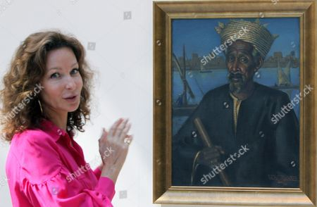 Isabelle De La Bruyere Christie's Director For Middle East Explains the Artwork 'Hag Aly' by Egyptian Artist Mahmoud Said During the Christie's Exhibition Held at Jumairah Emirates Twin Towers in Gulf Emirate of Dubai United Arab Emirates 23 October 2011 Christie's Eleventh Auction Will Take Place on 25 and 26 October 2011 Presenting Modern and Contemporary Arab Art As Well As Iranian and Turkish Arts the Auction Will Also Present Us Movie Star Elizabeth Taylor's Legendary Jewels United Arab Emirates Dubai