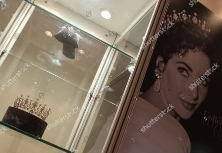 A View of the Mike Todd Diamond Tiara That Belonged to Us Movie Star Elizabeth Taylor (pictured Wearing It L) at the Christie's Exhibition Held at Jumairah Emirates Twin Towers in Gulf Emirate of Dubai United Arab Emirates 23 October 2011 Christie's Eleventh Auction Will Take Place on 25 and 26 October 2011 Presenting Modern and Contemporary Arab Art As Well As Iranian and Turkish Arts the Auction Will Also Present Us Movie Star Elizabeth Taylor's Legendary Jewels United Arab Emirates Dubai