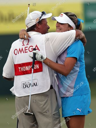 Stock Image of Us Golfer Alexis Thompson Hugs Her Father and Caddie As She Celebrates After Winning the Final Round at Omega Dubai Ladies Masters in Dubai United Arab Emirates 17 December 2011 United Arab Emirates Dubai