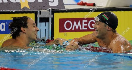 Krisztian Takacs (l) of Hungary and Jason Dunford (r) of Kenya Celebrate As Both Share Victory in the Men's 50m Freestyle Final During the Fina/arena Swimming World Cup 2011 at Hamdan Bin Mohammed Bin Rashid Sports Complex in Dubai United Arab Emirates 08 October 2011 United Arab Emirates Dubai