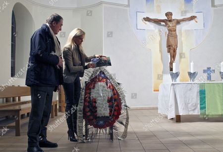 German Princess Maja Von Hohenzollern (r) Ambassador and Spokeswoman For the European Animal and Nature Protection Group (etn) Lays Flowers For Innocently Killed Dogs in St Katharinen Church in Kiev Ukraine 07 February 2012 During a Prayer the Etn and Ukrainian Animal Protection Groups Have Said That the Government of the Former Soviet Republic Has Ordered the Destruction of Thousands of Stray Dogs Sometimes by Shooting to Prepare the Country For Millions of International Tourists Expected During the Upcoming Euro 2012 Football Championship a More Effective Means of Controlling Stray Dogs is Neutering But Shortage of Government Funds and Lack of Empathy For Stray Animals Has Prevented Widespread Performance of the Operation in Ukraine Ukraine Kiev