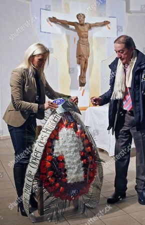 German Princess Maja Von Hohenzollern (l) Ambassador and Spokeswoman For the European Animal and Nature Protection Group (etn) Lays Flowers For Innocently Killed Dogs in St Katharinen Church in Kiev Ukraine 07 February 2012 During a Prayer the Etn and Ukrainian Animal Protection Groups Have Said That the Government of the Former Soviet Republic Has Ordered the Destruction of Thousands of Stray Dogs Sometimes by Shooting to Prepare the Country For Millions of International Tourists Expected During the Upcoming Euro 2012 Football Championship a More Effective Means of Controlling Stray Dogs is Neutering But Shortage of Government Funds and Lack of Empathy For Stray Animals Has Prevented Widespread Performance of the Operation in Ukraine Ukraine Kiev