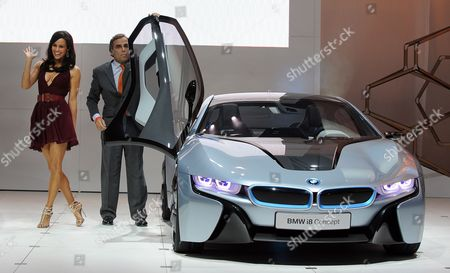 Us Actress Paula Patton (l) is Helped out of the Bmw I8 Concept Car That is Featured in the Upcoming Mission Impossible: Ghost Protocol Movie by Ludwig Willisch (r) President and Ceo of Bmw North America As the Car is Revealed at the 2011 La Auto Show in Los Angeles California Usa 16 November 2011 the Los Angeles Auto Show Will Surpass 50 Vehicle Debuts with Nearly 20 Highly-efficient 40 Mpg Plus Vehicles to Be Exhibited Patton Stars Along with Tom Cruise in the Movie United States Los Angeles