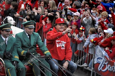 St Louis Cardinals Manager Tony Larussa (c) Acknowledges Cheers From Cardinals Fans While Riding in a Parade Celebrating the Cardinals Winning the 2011 World Series Near Busch Stadium in St Louis Missouri Usa on 30 October 2011 Team Manager Tony Larussa Rides on the Wagon the Cardinals Defeated the Texas Rangers 6-2 28 October 2011 to Win the Best-of-seven World Series 4-3 United States St. Louis