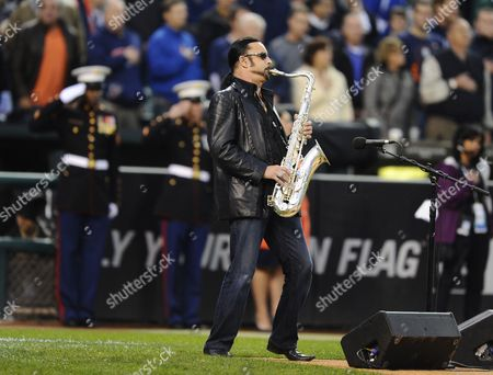Stock Photo of Us Saxophonist Alto Reed who Plays in the Band with Bob Seger and the Silver Bullet Band Plays the National Anthem Before the Start of Game Four of the American League Championship Playoffs Between the Texas Rangers and the Detroit Tigers at Comerica Park in Detroit Michigan Usa 12 October 2011 United States Detroit