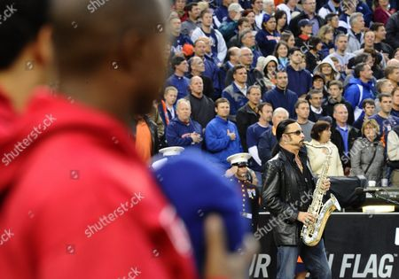 Stock Image of Us Saxophonist Alto Reed who Plays with Bob Seger and the Silver Bullet Band Plays the National Anthem Before the Start of Game Four of the American League Championship Playoffs Between the Texas Rangers and the Detroit Tigers at Comerica Park in Detroit Michigan Usa 12 October 2011 United States Detroit