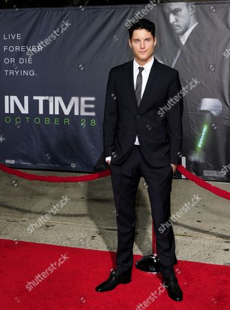 Stock Photo of Us Actor and Cast Member Toby Hemingway Arrives For the Premiere of 'In Time' in Los Angeles California Usa 20 October 2011 'In Time' is a Futuristic Tale where Life Stops at 25 and the Only Way to Stay Alive is to Earn Steal Or Inherit More Time United States Los Angeles