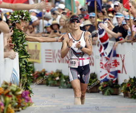 Caroline Steffen of Britain Receives an Encouraging Pat on Her Shoulder From Women's Champion Chrissie Wellington As She Approaches the Finish Line of the 2011 Ironman World Championship Steffen Finished Fifth with a Time of 9 Hours 7 Minutes and 32 Seconds in Kailua-kona Hawaii Usa on 08 October 2011 United States Kailua-kona