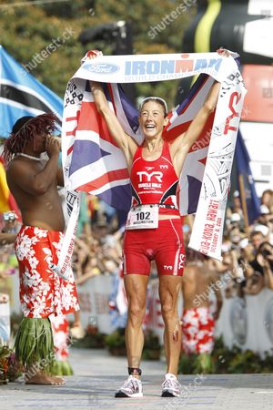 Chrissie Wellington of Britain Raises Her Arms in Victory As She Crosses the Finish Line with a Time of 8 Hours 55 Minutes and 8 Seconds Capturing the Women's Title in the 2011 Ironman World Championship in Kailua-kono Hawaii Usa on 08 October 2011 United States Kailua-kona