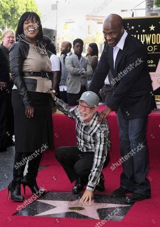 Stock Picture of Us Televangelist Jim Bakker (c) Touches the Star of Us Brother and Sister Singing Duo Cece (l) and Bebe (r) Winans During the Winan's Star Ceremony on the Hollywood Walk of Fame in Hollywood California Usa 20 October 2011 the Winans Received the 2 452nd Star on the Hollywood Walk of Fame United States Hollywood