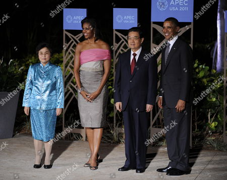 President of the United States of America Barack Obama (r) and First Lady Michelle Obama (2-l) Greet President of the People's Republic of China Hu Jintao (2-r) and Wife Liu Yongqing (l) Before the Asia Pacific Economic Cooperation Leaders Dinner Held at the Hale Koa Hotel in Honolulu Hawaii Usa 12 November 2011 United States Honolulu