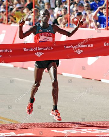 Moses Mosop of Kenya Crosses the Finish Line to Win the 2011 Bank of America Chicago Marathon with a New Course Record of 2:05:37 Hours in Chicago Illinois Usa 09 October 2011 the Previous Record was 2:05:41 Hours United States Chicago