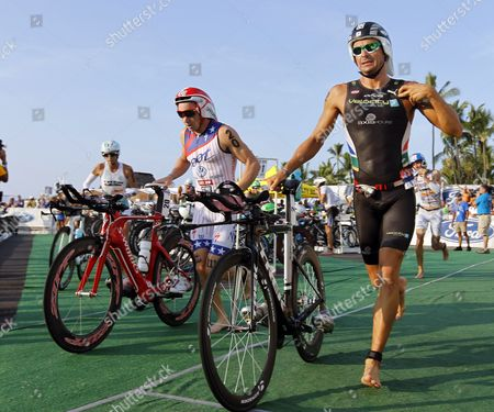 Ben Hoffman (l) of the Usa and Raynard Tissink (r) of South Africa Race Through the Transition Area to Begin the 112 Mile Biking Leg of the Ironman World Championship 2011 at the Kailua Bay in Kailua-kona Hawaii Usa 08 October 2011 the Triathletes Go Through a 2 4 Mile Swim Followed by a 112 Mile Bike Ride and a 26 2 Mile Marathon United States Kailua-kona
