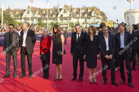 (l-r) Members of the Jury of the 37th Deauville Us Film Festival French Director Bruno Todeschini French Author Jean Rolin French Director Claire Denis French Actress Chiara Mastroianni French Director Olivier Assayas French Actress Nathalie Baye French Contemporary Dancer and Choreographer Angelin Preljocaj and French Musician of the Band Air Nicolas Godin Arrive For the Screening of the Movie 'The Help' by Us Director Tate Taylor and the Opening Ceremony of the 37th Annual Deauville American Film Festival in Deauville France 02 September 2011 the 2011 Edition of the Festival Running From 02 to 11 September 2011 Pays Tribute to Francis Ford Coppola France Deauville