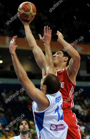 Turkish Enes Kanter (r) Tries to Score Near Serbian Nenad Krstic (l) During the Second Round Match Group E Between Serbia and Turkey at the Eurobasket 2011 in Vilnius Lithuania 11 September 2011 Lithuania Vilnius