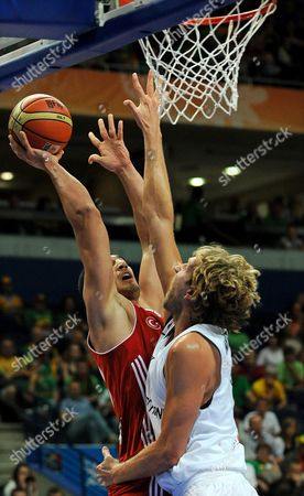 Germany's Dirk Nowitzki (r) Tries to Block Turkey's Enes Kanter (l) During the Second Round Basketball Match Between Germany and Turkey at the Eurobasket 2011 in Vilnius Lithuania 09 September 2011 Lithuania Vilnius