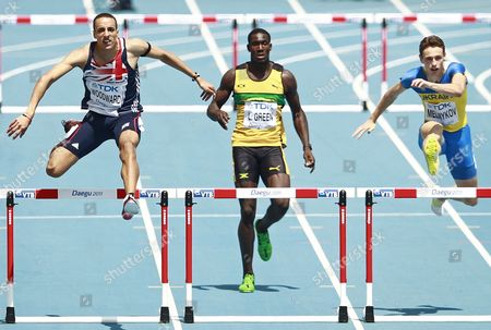 Stock Image of Nathan Woodward From Britain (l) Leford Green From Jamaica (c) and Stanislav Melnykov From Ukraine (r) Compete in the Mens 400m Hurdles Round 1 During the 13th Iaaf World Championships in Daegu Republic of Korea 29 August 2011 Korea, Republic of Daegu