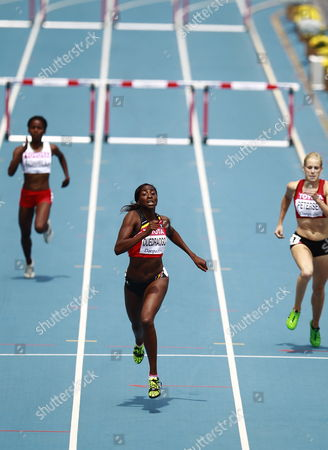 Elodie Ouedraogo From Belgium (c) Sara Petersen From Denmark (r) and Hanitrasoa Razanamalala From Madagascar (l) Compete in the Womens 400m Hurdles Round 1 During the 13th Iaaf World Championships in Daegu Republic of Korea 29 August 2011 Korea, Republic of Daegu