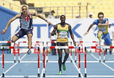 Nathan Woodward From Britain (l) Leford Green From Jamaica (c) and Stanislav Melnykov From Ukraine (r) Compete in the Mens 400m Hurdles Round 1 During the 13th Iaaf World Championships in Daegu Republic of Korea 29 August 2011 Korea, Republic of Daegu