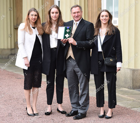 Sir David Hempleman Adams and Daughters Alicia, Amelia and Camilla during an Investiture Ceremony at Buckingham Palace in London