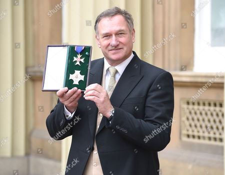 Sir David Hempleman Adams during an Investiture Ceremony at Buckingham Palace in London