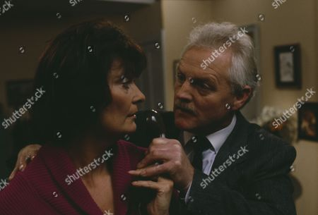 Stock Picture of Christopher Chittell (as Eric Pollard) and Kate Dove (as Elizabeth Pollard) as Elizabeth discovers evidence linking Pollard to the stolen cheques, Pollard threatens her and Elizabeth hits him in anger (Ep 1820 - 25th November 1993)