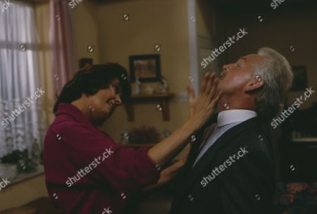 Stock Photo of Christopher Chittell (as Eric Pollard) and Kate Dove (as Elizabeth Pollard) as Elizabeth discovers evidence linking Pollard to the stolen cheques, Pollard threatens her and Elizabeth hits him in anger (Ep 1820 - 25th November 1993)
