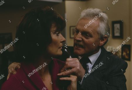 Stock Image of Christopher Chittell (as Eric Pollard) and Kate Dove (as Elizabeth Pollard) as Elizabeth discovers evidence linking Pollard to the stolen cheques, Pollard threatens her and Elizabeth hits him in anger (Ep 1820 - 25th November 1993)