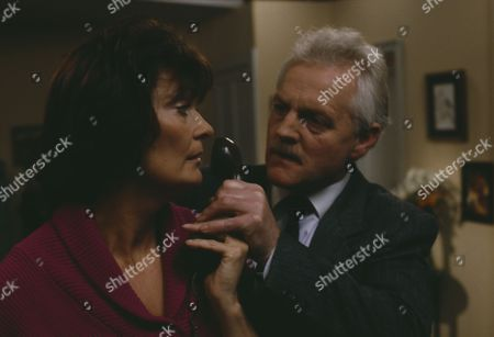 Christopher Chittell (as Eric Pollard) and Kate Dove (as Elizabeth Pollard) as Elizabeth discovers evidence linking Pollard to the stolen cheques, Pollard threatens her and Elizabeth hits him in anger (Ep 1820 - 25th November 1993)