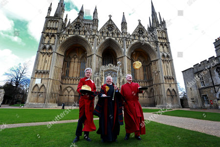 L-R: Acting Dean Jonathan Baker, Verger David Wood, Canon Ian Black take part in the Shrove Tuesday pancake race at Peterborough Cathedral