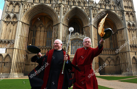 L-R: Verger David Wood, Canon Ian Black take part in the Shrove Tuesday pancake race at Peterborough Cathedral