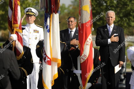 Us Vice President Joe Biden (r) Us Secretary of Defense Leon Panetta (c) and Us Chairman of the Joint Chiefs of Staff Admiral Mike Mullen (l) Watch the Presentation of Colors During the 10th Anniversary 9/11 Remembrance Ceremony at the Pentagon in Arlington Virginia Usa 11 September 2011 the Ceremony Commemorates the 184 People Killed at the Pentagon when Terrorists Crashed an Airliner Into the Building on 11 September 2001 United States Arlington