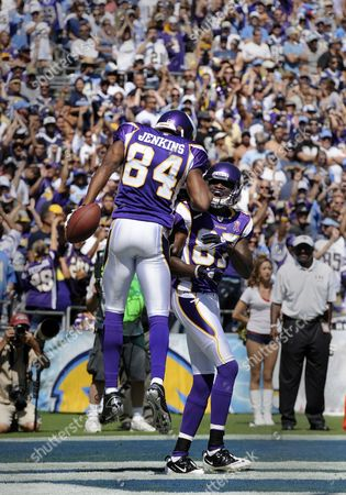 Minnesota Vikings Wide Receivers Michael Jenkins (l) and Bernard Berrian (r) Celebrate Jenkins' Three Yard Touchdown Reception in the Second Quarter Against the San Diego Chargers in San Diego California Usa 11 September 2011 United States San Diego