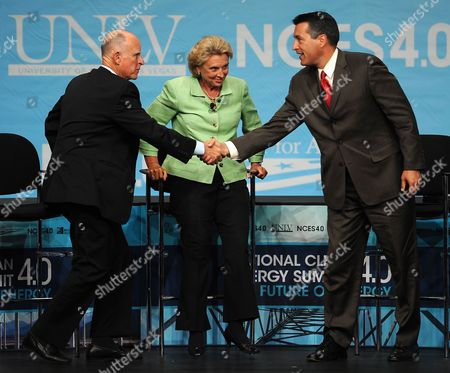 California's Democratic Party Governor Jerry Brown (l) Shakes Hands with Nevada's Republican Party Governor Brian Sandoval (r) As Washington Governor Christine Gregoire (c) Looks on Following the Western Governor's Panel on Energy at the National Clean Energy Summit 4 0: the Future of Energy in Las Vegas Nevada Usa 30 August 2011 the Energy Summit Brings Together Leaders in the Scientific Energy Environmental and Political Arenas to Exchange Ideas and Promote Sustainable Economical Clean Energy Efforts Products and Projects United States Las Vegas