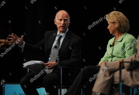 California Governor Jerry Brown (l) Makes Comments As Washington Governor Christine Gregoire (r) Listens During the Western Governor's Panel on Energy at the National Clean Energy Summit 4 0: the Future of Energy in Las Vegas Nevada Usa 30 August 2011 the Energy Summit Brings Together Leaders in the Scientific Energy Environmental and Political Arenas to Exchange Ideas and Promote Sustainable Economical Clean Energy Efforts Products and Projects United States Las Vegas