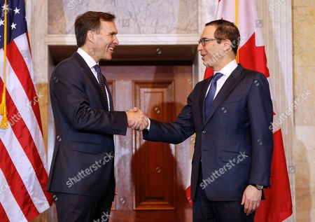 Donald Trump, Steven T. Mnuchin, William F. Morneau Treasury Secretary Steven Mnuchin shakes hands with Canadian Finance Minister William F. Morneau before the start of their bilateral meeting at the Treasury Department in Washington