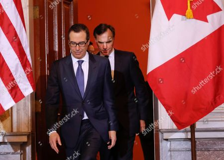 Donald Trump, Steven T. Mnuchin, William F. Morneau Treasury Secretary Steven Mnuchin and Canadian Finance Minister William F. Morneau, walk out before the start of their bilateral meeting at the Treasury Department in Washington