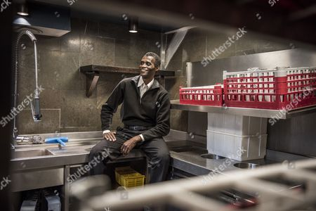 Employee Ali Sonko poses in the kitchen of Noma restaurant in Copenhagen, Denmark, 28 February 2017. Ali Sonko from Gambia, who has been working as a dishwasher at Noma for 14 years, was made a partner of the restaurant, head chef Rene Redzepi announced on 25 February 2017. The two Michelin star restaurant closed on 24 February and will reopen with a different concept at a new location by the end of 2017.