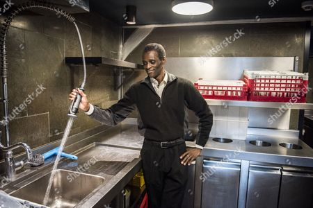 Stock Image of Employee Ali Sonko poses in the kitchen of Noma restaurant in Copenhagen, Denmark, 28 February 2017. Ali Sonko from Gambia, who has been working as a dishwasher at Noma for 14 years, was made a partner of the restaurant, head chef Rene Redzepi announced on 25 February 2017. The two Michelin star restaurant closed on 24 February and will reopen with a different concept at a new location by the end of 2017.