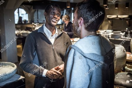 Employee Ali Sonko (L) speaks to a person at the Noma restaurant in Copenhagen, Denmark, 28 February 2017. Ali Sonko from Gambia, who has been working as a dishwasher at Noma for 14 years, was made a partner of the restaurant, head chef Rene Redzepi announced on 25 February 2017. The two Michelin star restaurant closed on 24 February and will reopen with a different concept at a new location by the end of 2017.