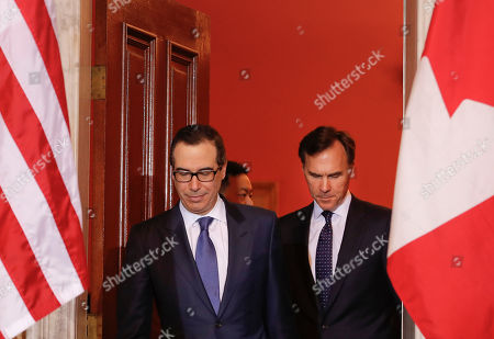 Donald Trump, Steven T. Mnuchin, William F. Morneau Treasury Secretary Steven T. Mnuchin, left, walks out with Canadian Finance Minister William F. Morneau, center, before the start of their bilateral meeting at the U.S. Treasury Building in Washington