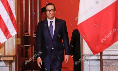 Donald Trump, Steven T. Mnuchin Treasury Secretary Steven Mnuchin walks out prior to his bilateral meeting with Canadian Finance Minister William F. Morneau at the Treasury Department in Washington