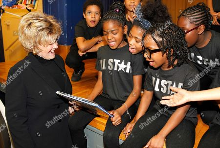 Stock Image of Author Kitty Kelley, left, talks with students at Tyler Elementary School to kick off National Reading Month with RIF, in Washington, D.C. Learn more at http://bit.ly/RIFLeVarPR