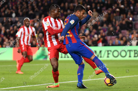 Rafinha Alcantara of FC Barcelona and Elderson Echiejile of Sporting de Gijon during the La Liga match between FC Barcelona and Sporting de Gijon played at the Camp Nou stadium, Barcelona, Spain on 01th March of 2017