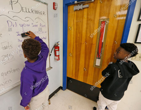 """Alex Hibbert, Jaden Piner Jaden Piner, left, 13, corrects his name on a whiteboard mentioning him and Alex Hibbert, right, 12, for being at the Academy Awards for their part in """"Moonlight,"""" as they attend drama class at Norland Middle School, in Miami Gardens, Fla. The film garnered three Oscars Sunday night, including the award for best picture"""