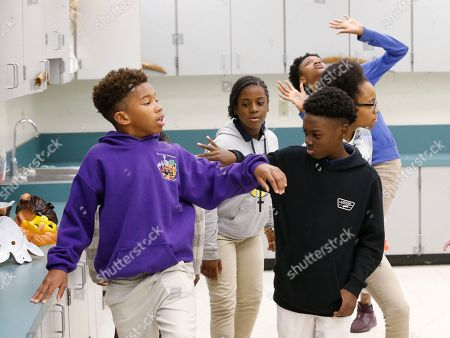 """Alex Hibbert, Jaden Piner Jaden Piner, left, 13, and Alex Hibbert, right, 12, run through a drill in which they must show a range of emotions during drama class at Norland Middle School, in Miami Gardens, Fla. The two acted in the Oscar winning film """"Moonlight."""" The film garnered three Oscars Sunday night, including the award for best picture"""