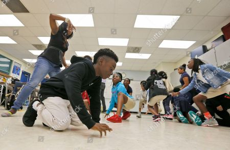 """Alex Hibbert, Tanisha Cidel Drama teacher Tanisha Cidel, left rear, instructs students to be a lion as Alex Hibbert, left foreground, 12, crawls on the floor during drama class at Norland Middle School, in Miami Gardens, Fla. Cidel, Hibbert and another student acted in Oscar winning film """"Moonlight."""" The film garnered three Oscars Sunday night, including the award for best picture"""