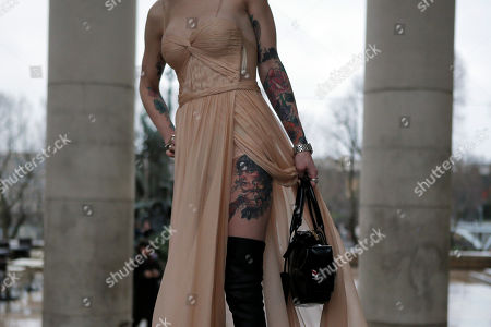 Fashionista Danita Short poses for photographers outside the Palais de Tokyo after the show of Rochas' Fall-Winter 2017-2018 ready to wear fashion collection presented in Paris