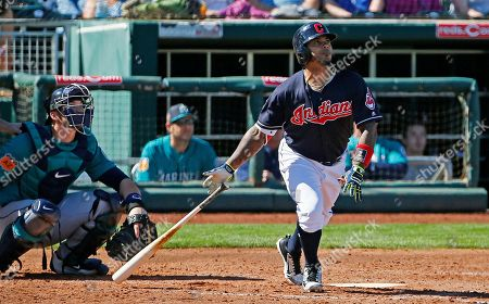 Cleveland Indians second baseman Michael Martinez, right, watches the flight of his home run as Seattle Mariners catcher Mike Zunino, left, looks on during the third inning of a spring training baseball game, in Goodyear, Ariz